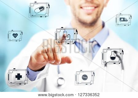 Doctor hand pushing button on virtual screen. Medical technology concept