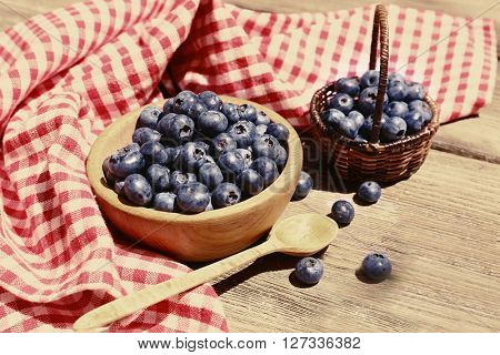 Fresh blueberries on wooden table. Retro style