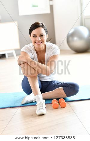Woman at home doing fitness exercises