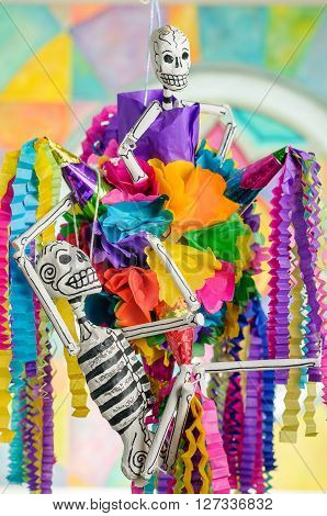 Traditional mexican pinata with skeletons on day of the dead