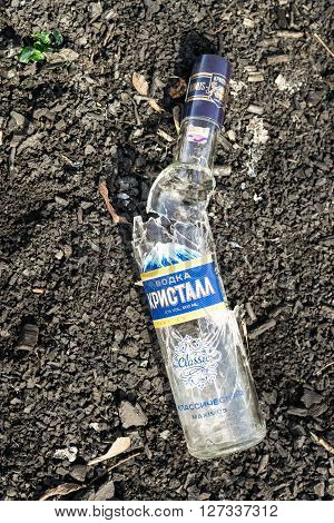 REIFKA - RUSSIA 9TH APRIL 2016 - Broken vodka bottles can cause injuries to unsuspecting families at summer picnic areas in Reifka Russia on the 9th of April 2016.