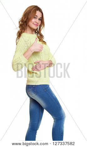 young girl casual dressed jeans and a green sweater posing in studio show best gesture on white background