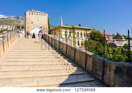 MOSTAR BOSNIA AND HERZEGOVINA - SEPTEMBER 1 2009: The stairs of the new Stari Most (old bridge) reconstructed from local tenelia stone.