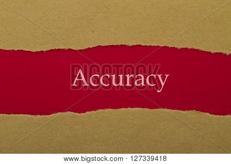Accuracy word written under brown torn paper.