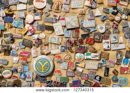 REIFKA - RUSSIA 9TH APRIL 2016 - Vibrant colored image of various Russian themed metal enamel badges on display at a local market stall in Reifka, Russia in April 2016.