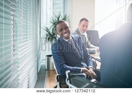 Happy businessman in office