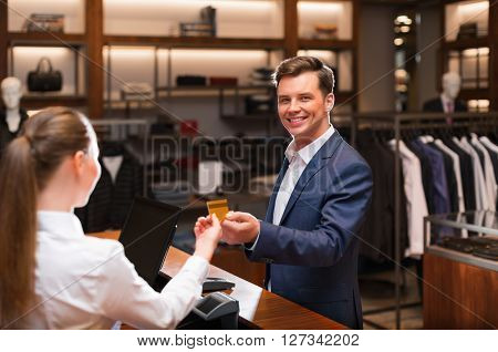 Smiling man in suit in shop