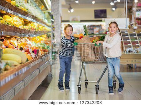 Children with cart indoors
