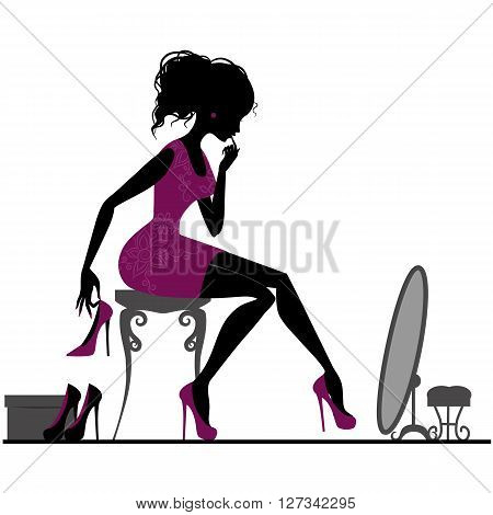 Silhouette of elegant girl in show-room trying on shoes