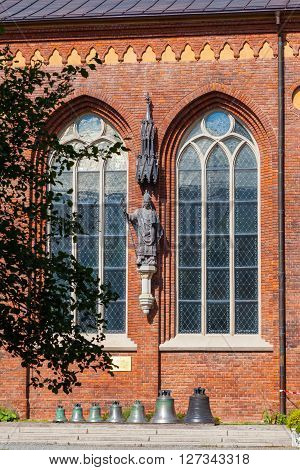 Riga, Latvia - 25-august-2015: Sculpture Of Albert, The First Bishop Of Riga And Bronze Bells Inside