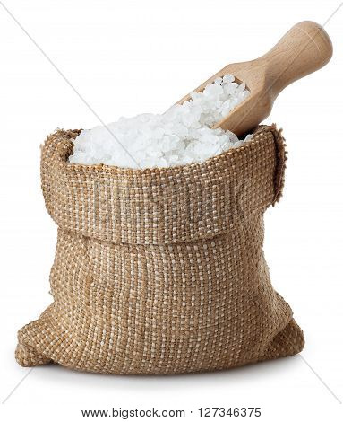 sea salt in burlap bag with wooden scoop isolated on white background. Condiment crystals of salt