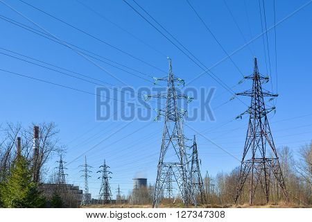 Thermal power station and transmission lines in the forest.