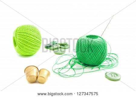 Thread, Thimbles And Green Buttons
