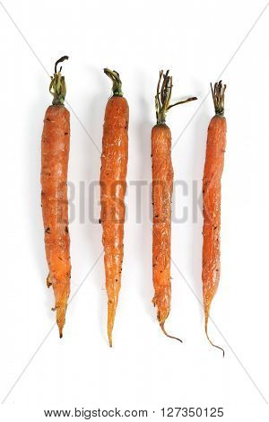 Food, vegetables. Baked carrots on a white background