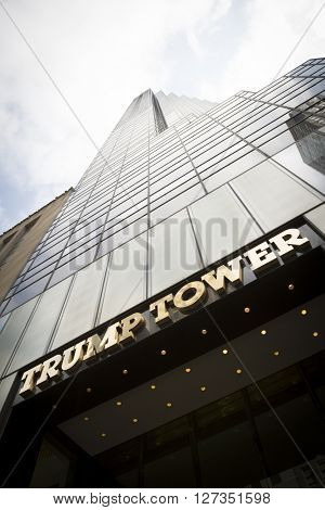 NEW YORK - MAR 27 2016: Low angle of the gold facade of Trump Tower, the 68 story skyscraper home to Trump Organization political headquarters, luxury offices and residences, Manhattan, March 27 2016.