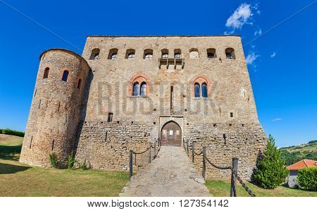 Facade and entrance to old medieval castle of Prunetto in Piedmont, Northern Italy.