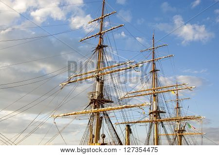 masts of the sailing vessel against the blue sky