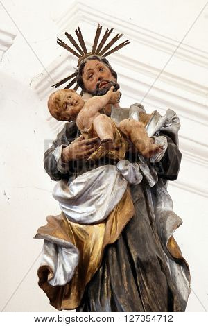 KOTARI, CROATIA - SEPTEMBER 16: Statue of Saint Joseph with baby Jesus on the Saint Anthony altar in the church of Saint Leonard of Noblac in Kotari, Croatia on September 16, 2015.