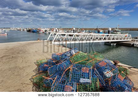 Traps for fish and shellfish on the dock. The ships in the background.