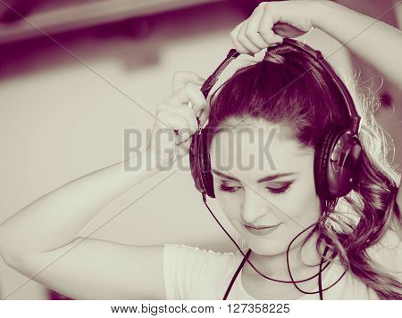 Hobby music expression and free time. Young girl listen music dance with hands on headphones. ** Note: Soft Focus at 100%, best at smaller sizes