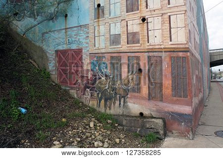 JOLIET, ILLINOIS / UNITED STATES - APRIL 19, 2015: A horse-drawn fire truck appears to come out of Engine House 1 on Jefferson Street near downtown Joliet.