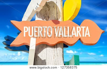 Puerto Vallarta signpost with beach background