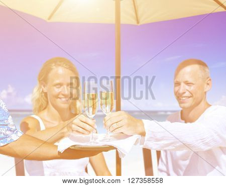 A couple celebrating on the beach.