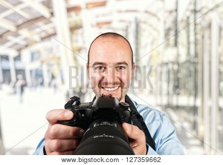 portrait of photographer and modern building background