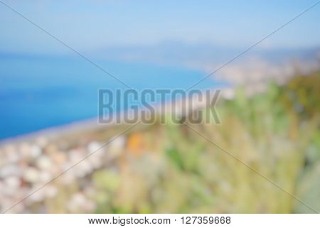 image blurry of town and sea