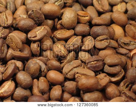sifted roasted black coffee beans closeup . ** Note: Shallow depth of field