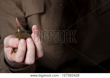 woman's hand holding bullets.