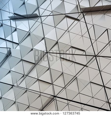 Abstract illustration of modern architecture with triangles on facade