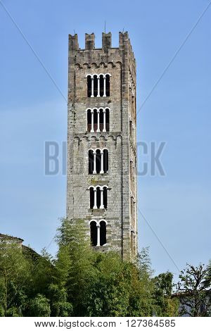 Romanesque belfry of San Frediano Basilica similar to a medieval tower in the historic center of Lucca