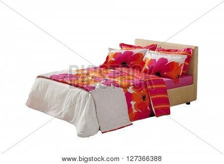 colorful floral covers on double bed isolated on white background