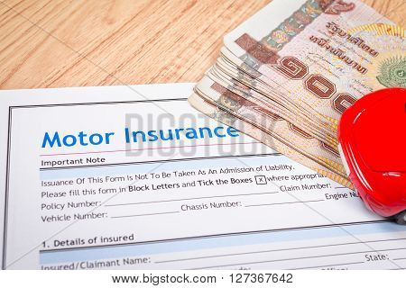Motor Or Car Insurance Application And Thai Banknotes Money Form With Car; Document And Car Is Mock-
