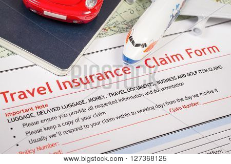 Travel Insurance Claim Application Form On Table, Business And Risk Concept; Document,car And Plane