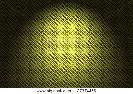 spotlight on yellow carbon fiber background and texture