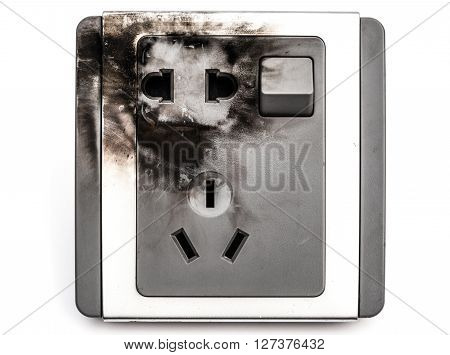 burnt out electric socket close up on a white background