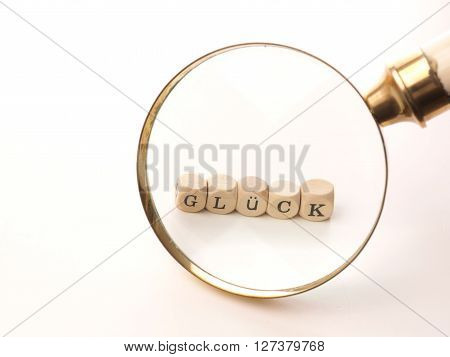 Searching for luck magnifier and wooden dices with the German word of luck