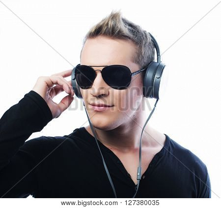 life style and people concept:  Happy young man listening to music with headphones