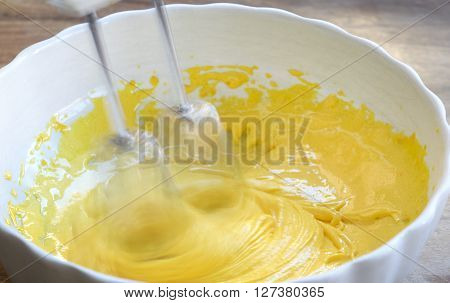 preparing a spongee cake with the ingredients worked with a food-mixer