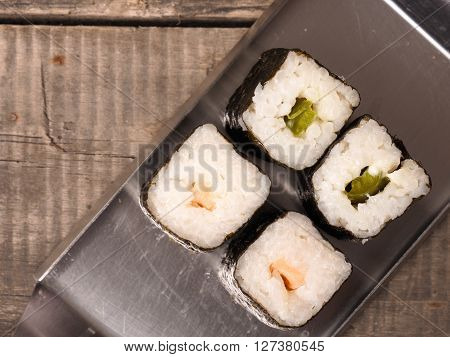 Sushi hoso maki on a stell plate top view