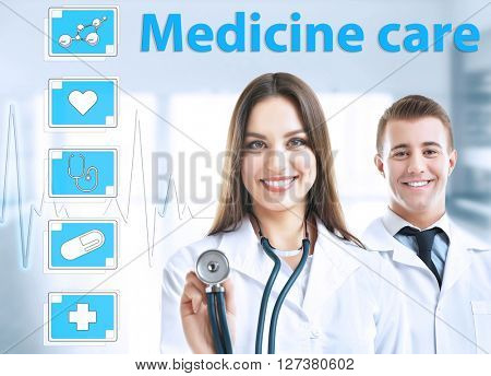 Two doctors and medicine icons on virtual screen. Medical technology concept