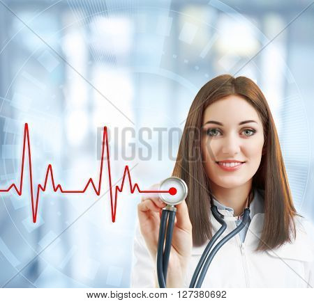 Young beautiful doctor with stethoscope on virtual screen. Medical concept