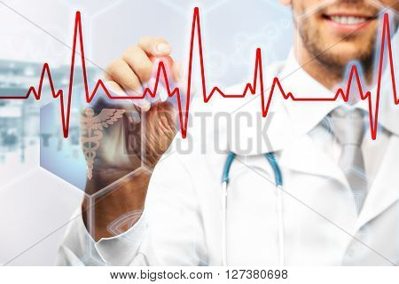Doctor drawing cardiogram on virtual screen. Medical concept