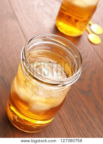 Two glasses of cold ice tea with ice cubes