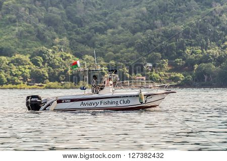 Hell-Ville Madagascar - December 19 2015: The speedboat of the Aviavy Fishing Club floats along the Hell-Ville harbour Nosy Be Island Madagascar.
