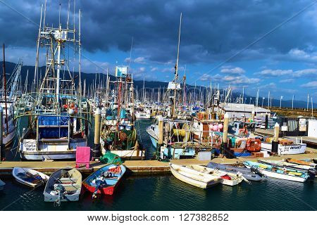 April 29, 2016 in Santa Barbara, CA: Commercial Fissing Vessels, row boats, motor boats, and sail boats docked at the Santa Barbara Harbor Marina where locals and tourists use and rent boats taken in Santa Barbara, CA