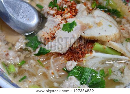 rice noodle topping fish line and pork dressing cayenne pepper