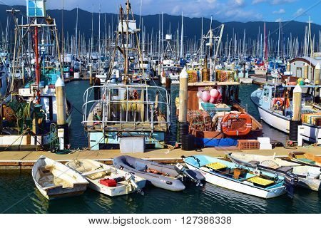 April 20, 2016 in Santa Barbara, CA:  Fishing Boats and row boats docked at the Santa Barbara Marina where people can rent boats or travel on their own yachts and Fishing Boats taken in Santa Barbara, CA